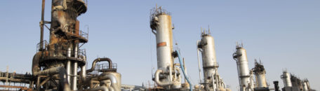 Workers repair a damaged refining tower at Saudi Aramco's Abqaiq crude oil processing plant following a drone attack in Abqaiq, Saudi Arabia, on Friday, Sept. 20, 2019. Saudi Aramcorevealed the significant damage caused by an aerial strike on its Khurais oil field and Abqaiq crude-processing plant last weekend, and insisted that the sites will be back to pre-attack output levels by the end of the month. Photographer: Faisal Al Nasser/Bloomberg via Getty Images